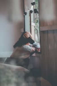 picture of a woman leaning looking out of a window
