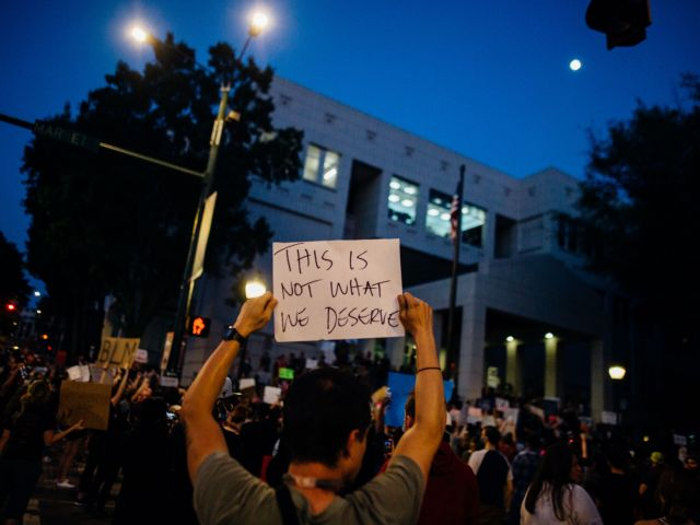 protesters-holding-signs-4552838